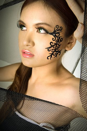 Tribal face tattoo idea for girls.