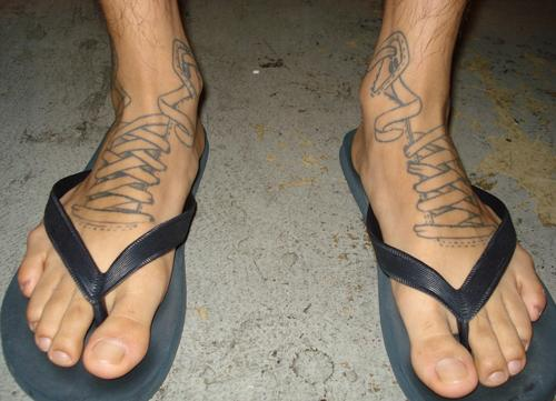Sneaker foot tattoo for men.