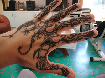 Name tattoo on side of hand. Tribal Hand Tattoos