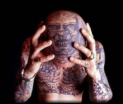 tattoos on head. lion head tattoos. skull head