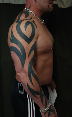 tattoo sleeve ideas for black men. Black with hints of red. Thick artwork idea.