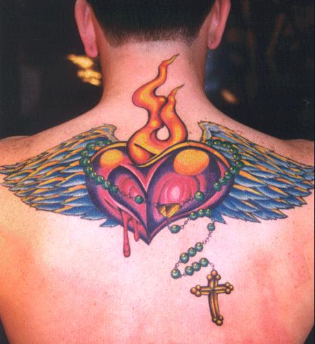 Wings, flames and cross on upper back