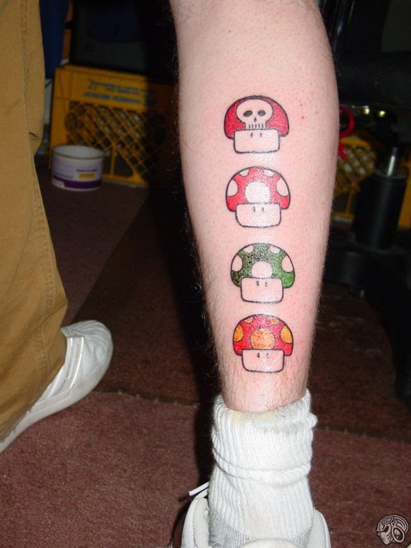 tattoos on back of leg. Mario mushrooms on ack of