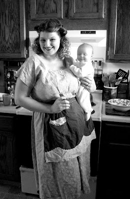 1950s housewife and baby with 50s dress and apron via va-voom vintage