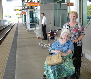Mom and me waiting for the train