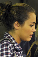 miley-ear-tattoo-05.jpg