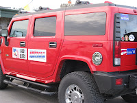 Hummer with American bumper stickers
