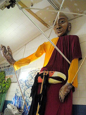 giant buddha puppet
