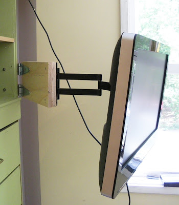 home-made extension arm to add to a purchased tv swivel arm