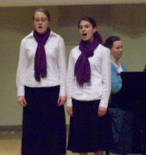 Missie and Britnee singing their duet at competition