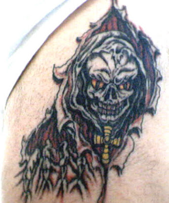 Skull Tattoo Designs - Dare to Compare What does the grim reaper convey to