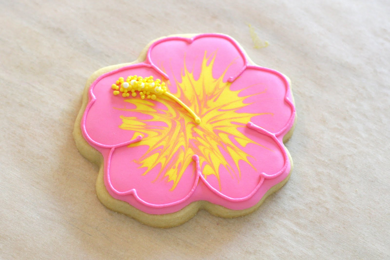 Cookie decorating how to make pretty hibiscus cookies glorious treats finish the cookie by outlining in a thick consistency icing izmirmasajfo