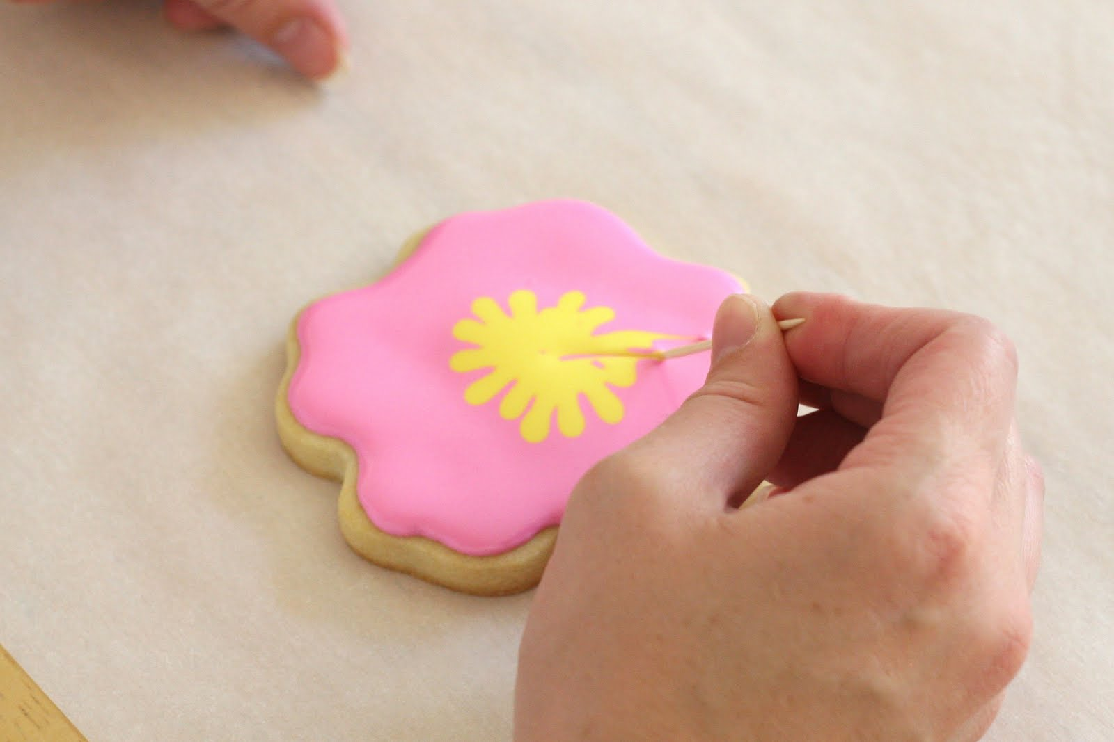 Cookie decorating how to make pretty hibiscus cookies glorious treats continue around the cookie until the desired design is achieved izmirmasajfo