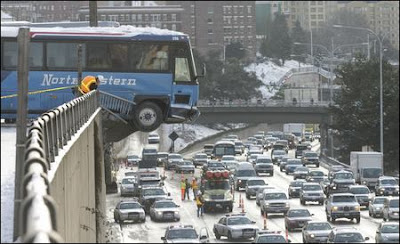 Two buses, which had 80 students combined, dangle 20-to-30 feet above I-5 after sliding down snow and ice covered E. Thomas St. and crashing through the Melrose Ave. E. guardrail. December 19, 2008. photo Dan DeDelong/SeattlePI.