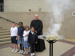 Second Grade Students Help Burn the Palms 1