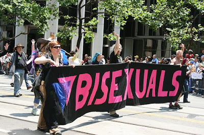 San Francisco Queer Pride marchers behind banner that says bisexuals