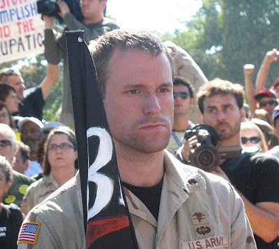 anti-war vet standing at attention