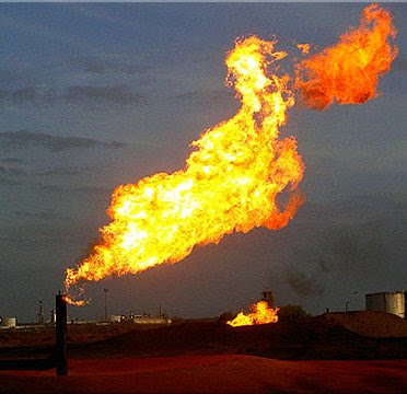 Photo of Natural Gas burning off at oil field