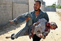Man Carries wounded child
