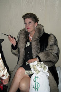 Halloween costume with woman dressed up as greedy rich person