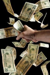 hand of man grabbing flying money