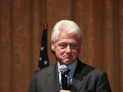 photo of a deranged looking Bill Clinton