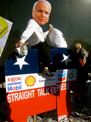 Satirical image showing John McCain holding money on top of straight talk express bus decorated by corporate logos