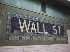 wall street tile mosaic sign in subway station