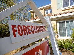 house with foreclosure sign