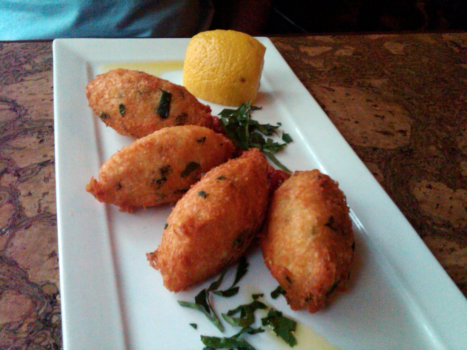 were served with lemon to squeeze over top, drizzled with a Portuguese ...
