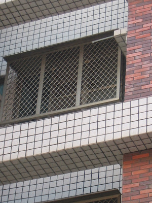 bars on windows in apartment in Tainan City Taiwan