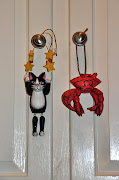 .and after the seaside trip, the souvenirs: the cat is an obvious enough .