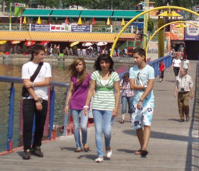 Young people crossing bridge