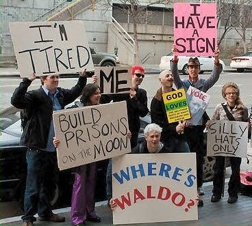 Meta Protest Sign: 'Build Prisons on the Moon'