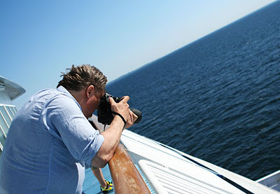 Peder takes photos at the ferry to Denmark