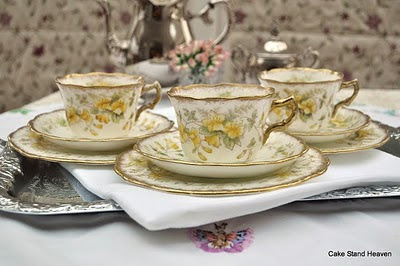 antique yellow teacups saucers and tea plates