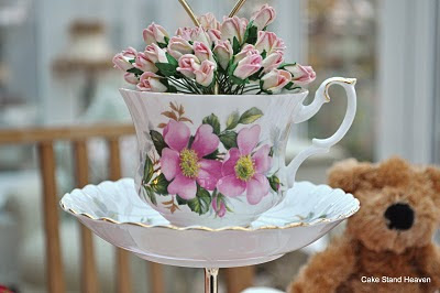 pink roses in a teacup topped cake stand