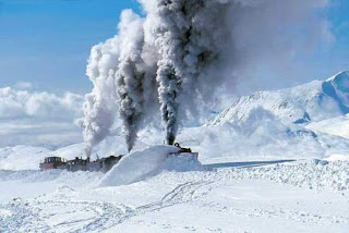 train crossing the tick snow