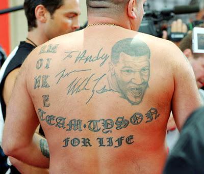 Mike Tyson tattoo-autographed my back!