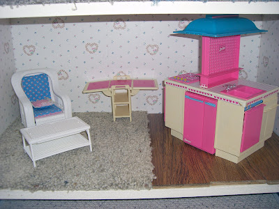 the kitchen floor is a remnant of the wood flooring from that same mi house chewy and scooter love the barbie kitchen because it came with a ton of teeny
