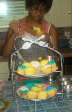 My daughter icing cupcakes