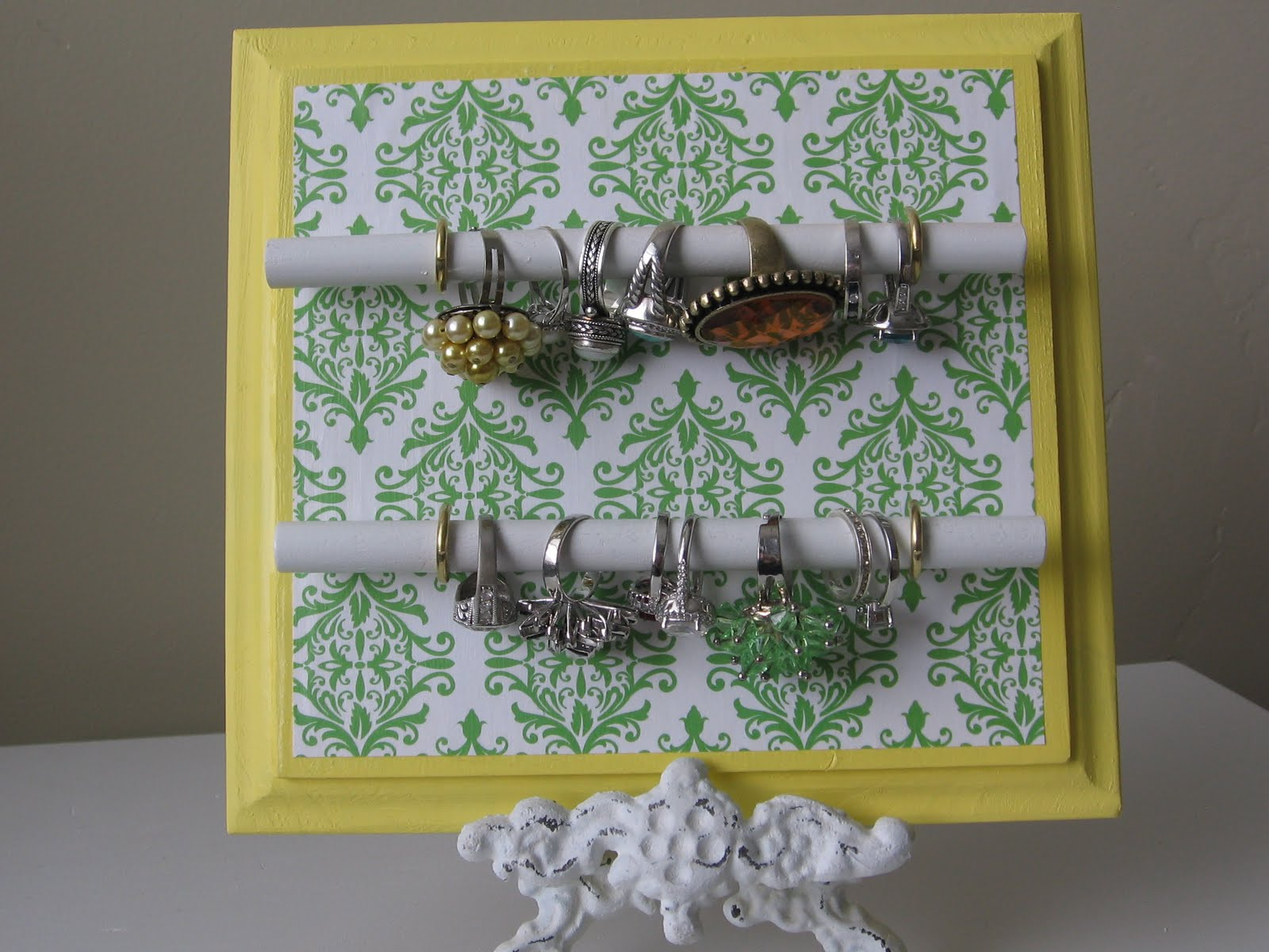 Recycle a tennis racket into a jewelry display · Recycled Crafts