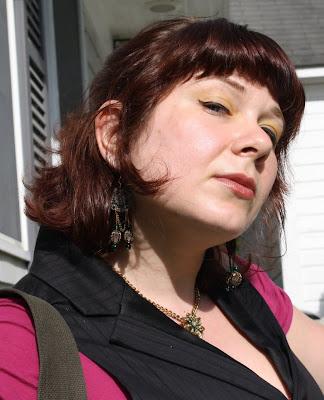 yellow eyeshadow, pinstripe vest