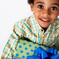 Little boy with wrapped present