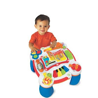 Learn and Groove Table with cute little boy