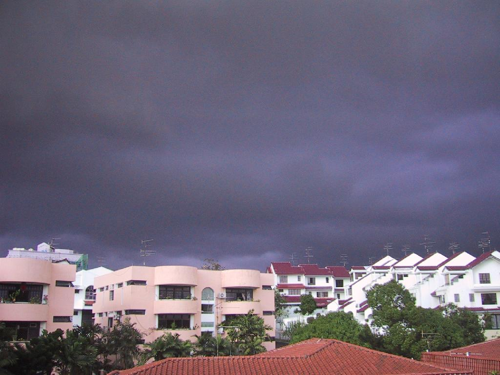 [Braddell+Heights+Private+Estate+with+Condo+(Now+Redevelops+to+Arcacia)+and+Looming+Rain+Clouds+in+the+Background.jpg]