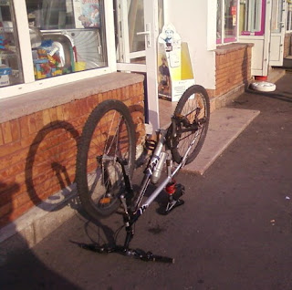 Mountain Bike Upside Down Outside Shop