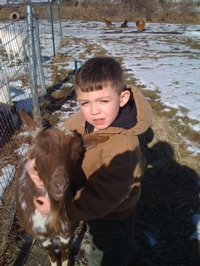 Aaron with his goat Rusty Jones