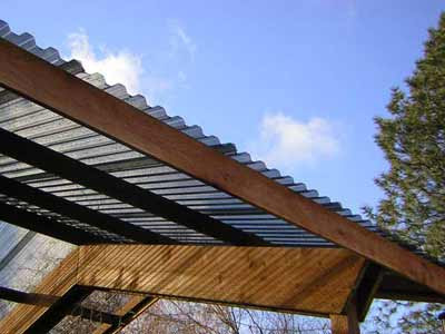 Metal roof corrugated metal roof pergola for Roof covering materials