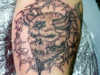 Demonic face thing demon tattoo